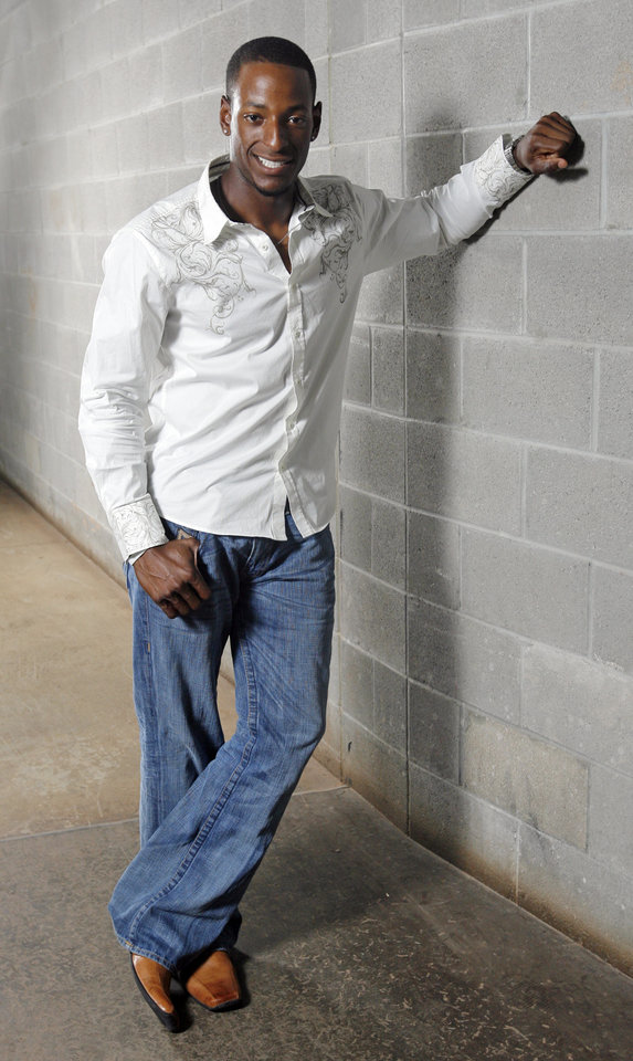 Photo - MINOR LEAGUE BASEBALL: Greg Golson, voted best dressed by the other Oklahoma City RedHawks, poses for a photo at the AT&T Bricktown Ballpark in Oklahoma City, Friday, July 10, 2009. Photo by Nate Billings, The Oklahoman  ORG XMIT: KOD