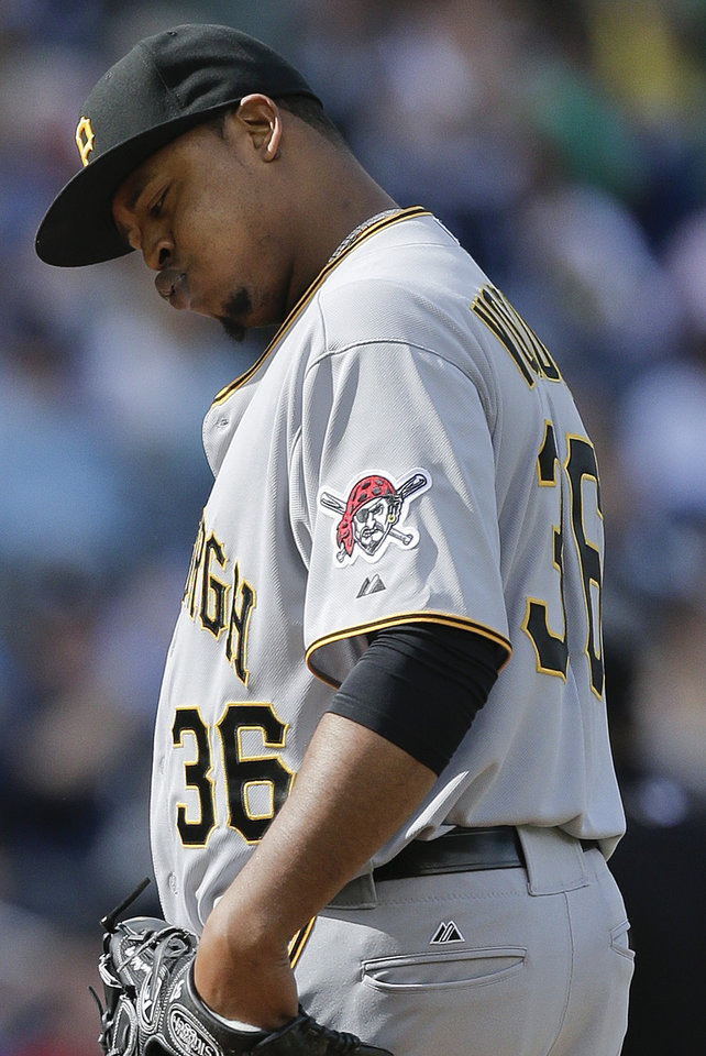 Photo - Pittsburgh Pirates starting pitcher Edinson Volquez reacts after giving up a solo home run to New York Yankees' Zoilo Almonte (24) during the third inning of a baseball game, Saturday, May 17, 2014, in New York. (AP Photo/Julie Jacobson)