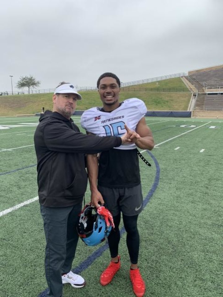 Photo -  Bob Stoops and Jerrod Heard clown around during a Dallas Renegades practice. [PHOTO PROVIDED]