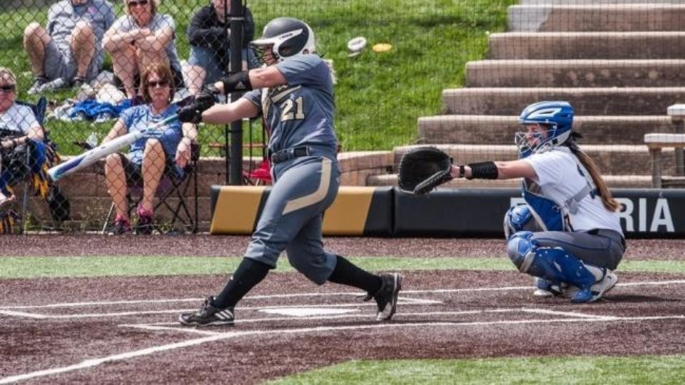 Photo -  Jacie Stephens Cochran swings at a pitch for Emporia State in Kansas. Cochran was a second-team All-MIAA selection her senior year. [Photo provided by Emporia State University]
