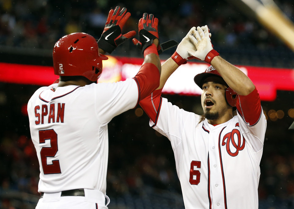 Photo - Washington Nationals' Denard Span (2) celebrates with Anthony Rendon (6) after being driven home by Rendon's two-run homer during the first inning of a baseball game against the Los Angeles Dodgers at Nationals Park, Monday, May 5, 2014, in Washington. (AP Photo/Alex Brandon)