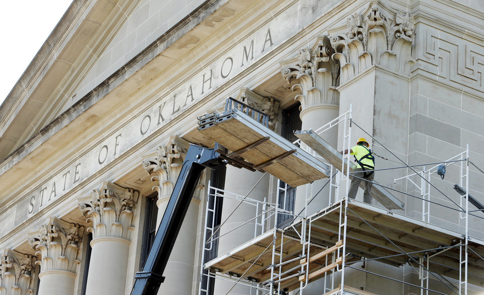 Photo -  STATE CAPITOL RENOVATION   Renovation to the exterior of the State Capitol Building begins with scaffolding on Wednesday, Aug. 3, 2016 in Oklahoma City, Okla. Photo by Steve Sisney, The Oklahoman