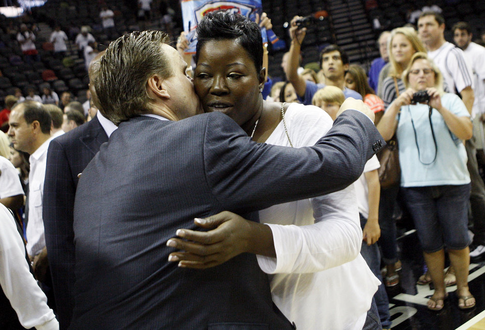 Oklahoma City head coach Scott Brooks hugs Wanda Pratt, Kevin Durant\'s mother, after Game 5 of the Western Conference Finals between the Oklahoma City Thunder and the San Antonio Spurs in the NBA basketball playoffs at the AT&T Center in San Antonio, Monday, June 4, 2012. The Thunder won, 108-103. Photo by Nate Billings, The Oklahoman