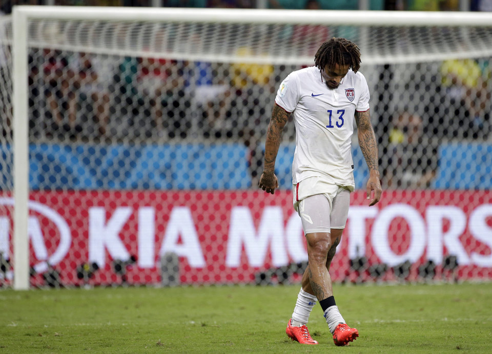 Photo - United States' Jermaine Jones walks off the pitch at the end of the extra time during the World Cup round of 16 soccer match between Belgium and the USA at the Arena Fonte Nova in Salvador, Brazil, Tuesday, July 1, 2014. Belgium held on to beat US 2-1 in extra time.(AP Photo/Felipe Dana)