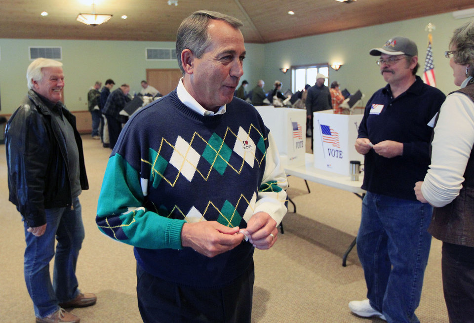Photo -   House Speaker John Boehner (R-Ohio) talks with poll workers after voting at Ronald Reagan Lodge, Tuesday, Nov. 6, 2012, in West Chester, Ohio. (AP Photo/Al Behrman)