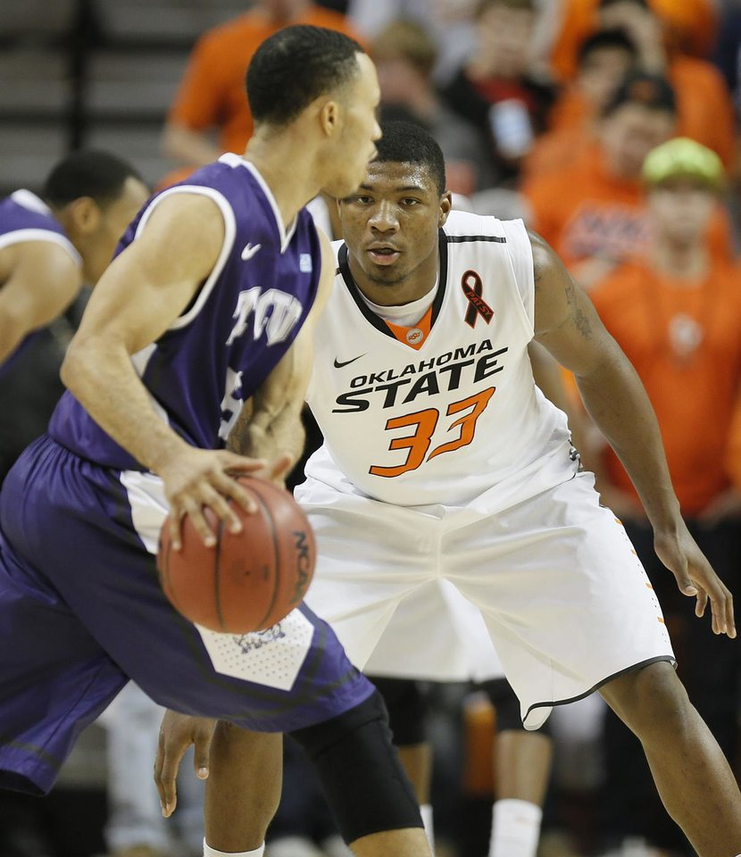 Oklahoma State's Marcus Smart (33) defends on TCU's Kyan Anderson (5) during the college basketball game between Oklahoma State University Cowboys (OSU) and Texas Christian University Horned Frogs (TCU) at Gallagher-Iba Arena on Wednesday Jan. 9, 2013, in Stillwater, Okla. 