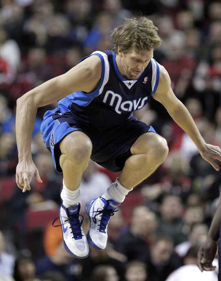 Dallas Mavericks forward Dirk Nowitzki, from Germany, jumps in the air just before the jump ball to start the game during an NBA basketball game against the Portland Trail Blazers in Portland, Ore., Tuesday, Jan. 29, 2013. (AP Photo/Don Ryan)