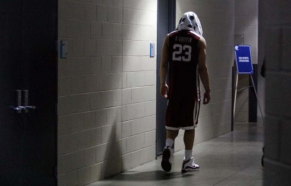 Photo -  Oklahoma's Blake Griffin walks to a post game interview after the 72-60 loss to North Carolina in the Elite Eight game of NCAA Men's Basketball Regional between the University of North Carolina and the University of Oklahoma at the FedEx Forum on Sunday, March 29, 2009, in Memphis, Tenn.  PHOTO BY CHRIS LANDSBERGER, THE OKLAHOMAN