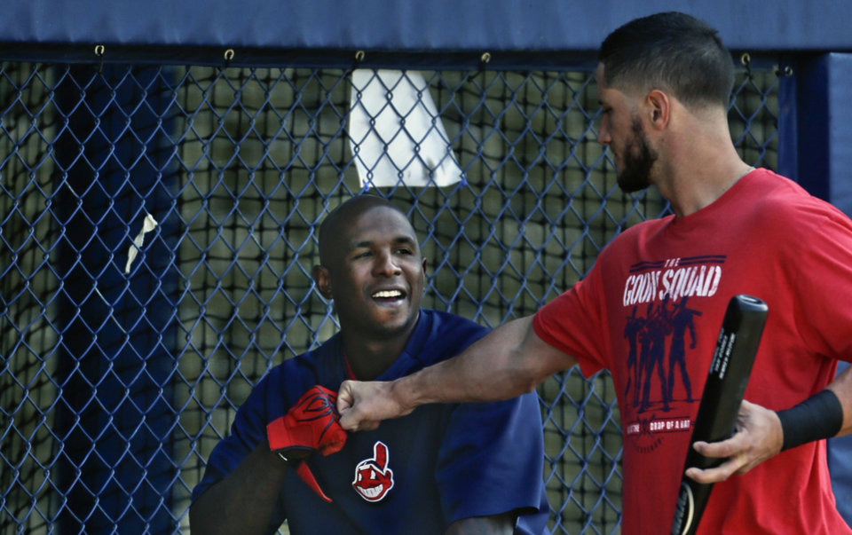Photo - Cleveland Indians catcher Yan Gomes,  right, knocks knuckles with right fielder Nyjer Morgan before a spring exhibition baseball game on Friday, March 28, 2014, in San Diego. (AP Photo/Lenny Ignelzi)