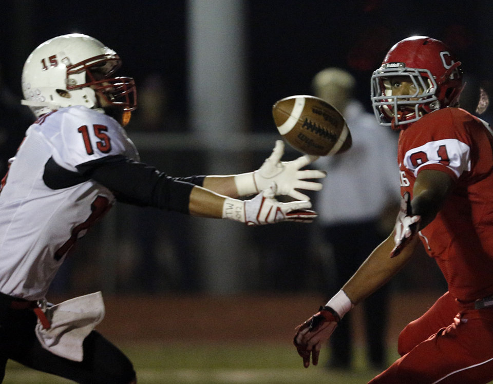 Photo - Claremore's Caleb Webster (15) and Carl Albert's Trenton Ball (81) fight for to catch a fumble during a high school football game between Carl Albert and Claremore in Midwest City, Friday, Nov. 16, 2012.  Photo by Garett Fisbeck, The Oklahoman