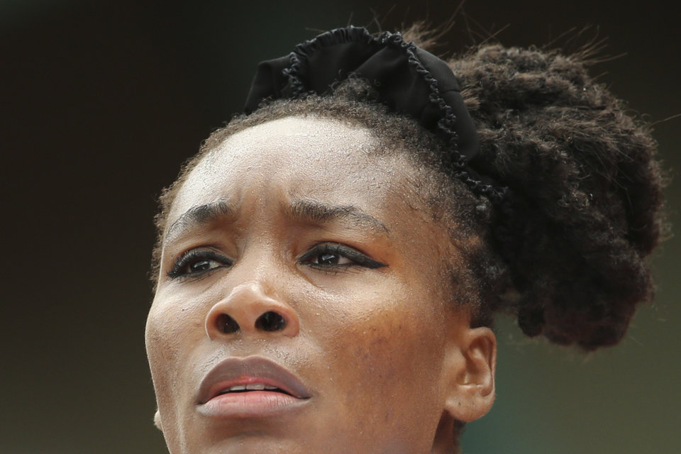 Venus Williams of the U.S. looks at the ball as she prepares to serve during the second round match of the French Open tennis tournament against at the Roland Garros stadium, in Paris, France, Wednesday, May 28, 2014. (AP Photo/David Vincent)