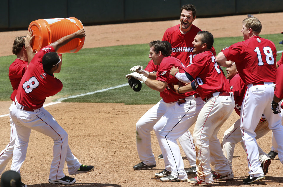 The Redhawks' prepare to pour water on Matt Duffy, center after driving in the winning run during their game against the Salt Lake Bees at the Chickasaw Bricktown Ballpark in Oklahoma City, Wednesday June 11, 2014. Photo By Steve Gooch, The Oklahoman