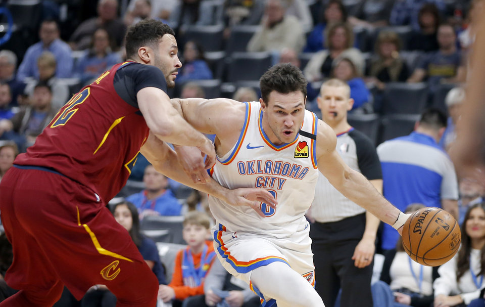 Photo - Oklahoma City's Danilo Gallinari (8) goes past Cleveland's Larry Nance Jr. (22) during an NBA basketball game between the Oklahoma City Thunder and the Cleveland Cavaliers at Chesapeake Energy Arena in Oklahoma City, Wednesday, Feb. 5, 2020. Oklahoma City won 109-103. [Bryan Terry/The Oklahoman]