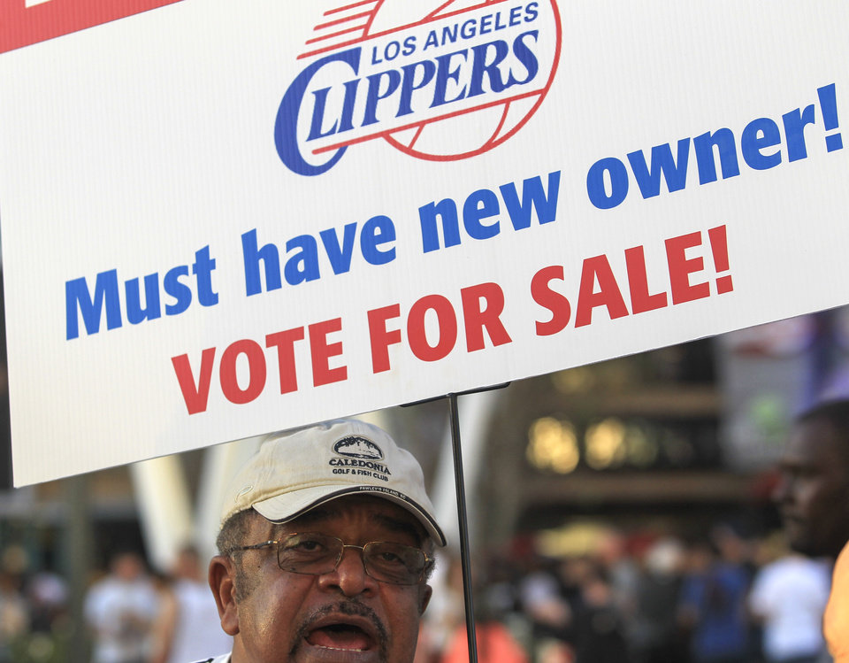 Sam Wright protests against Los Angeles Clippers owner Donald Sterling, outside Staples Center before Game 5 of the Clippers\' opening-round NBA basketball playoff series against the Golden State Warriors on Tuesday, April 29, 2014, in Los Angeles. NBA Commissioner Adam Silver announced Tuesday that Sterling has been banned for life by the league for making racist comments that hurt the league. (AP Photo/Ringo H.W. Chiu)