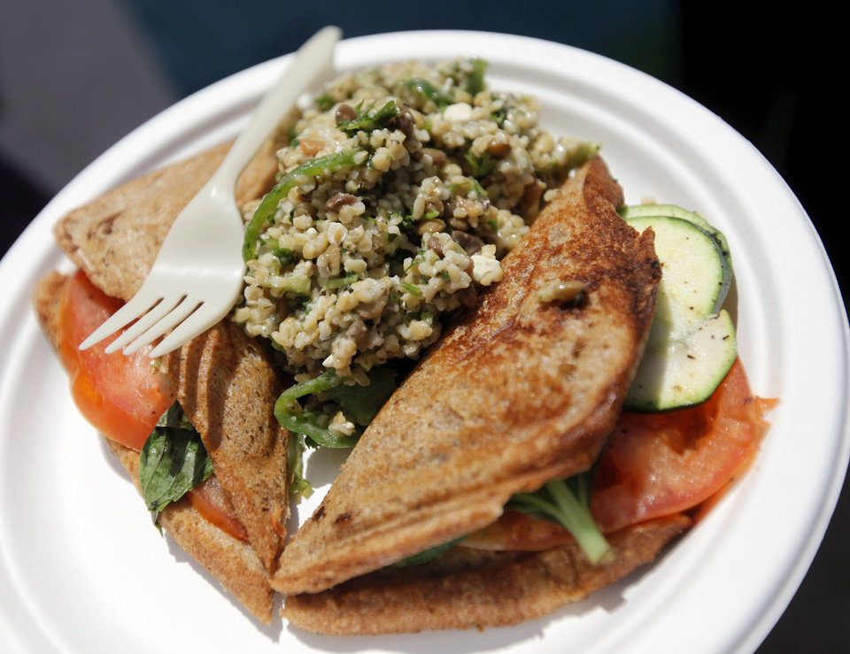 Photo - A Zucchini, Cheese, Tomato & Basil Jaffle w/Lentil Tabouli Salad from the Australian Jaffles and Salads & KCSC-FM booth on International Food Row during the Festival of the Arts in downtown Oklahoma City, Wednesday, April 25, 2012. Photo by Nate Billings, The Oklahoman