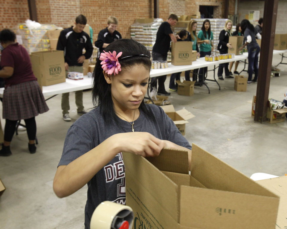 Kylie Staley assembles boxes as she and other students from Destiny Christian School volunteer at the City Rescue Mission in Oklahoma City, OK, Monday, Nov. 14, 2011. The Mission is gathering food and donations for its Thanksgiving food delivery. By Paul Hellstern, The Oklahoman
