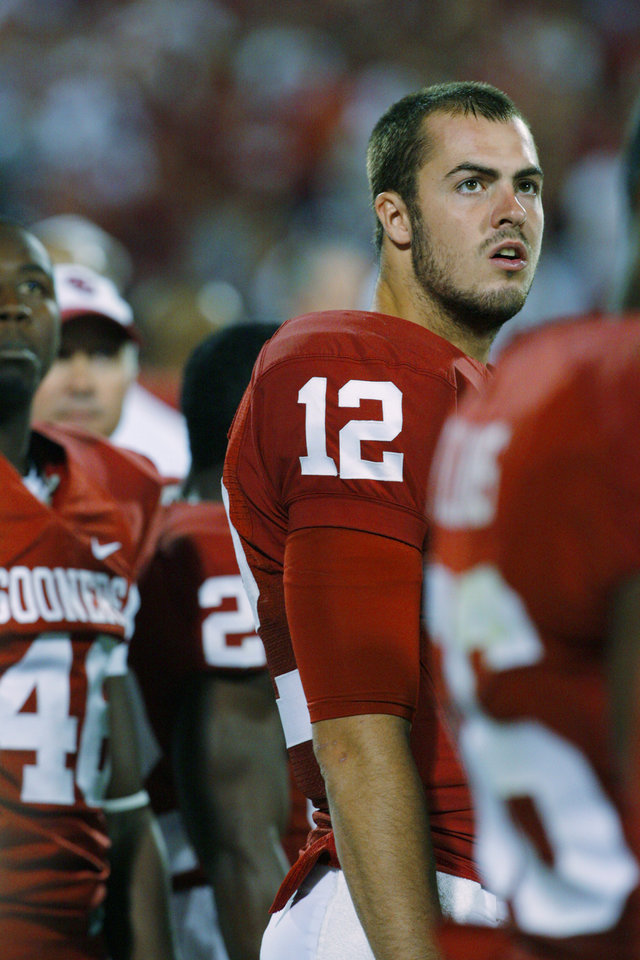 Photo - Quarter back Landry Jones (12) looks at the clock during the second half of the college football game between the University of Oklahoma Sooners (OU) and the Iowa State Cyclones (ISU) at the Glaylord Family-Oklahoma Memorial Stadium on Saturday, Oct. 16, 2010, in Norman, Okla.  Photo by Steve Sisney, The Oklahoman