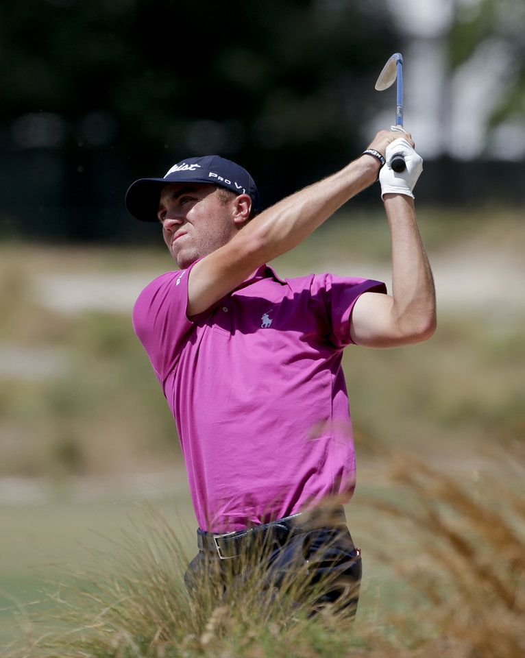 Photo - Justin Thomas hits out of a fairway bunker on the 14th hole during a practice round for the U.S. Open golf tournament in Pinehurst, N.C., Tuesday, June 10, 2014. The tournament starts Thursday. (AP Photo/Chuck Burton)