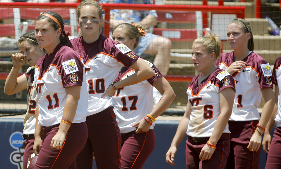 Virginia Tech players leave the dugout after their loss in the Women's College World Series game between Florida and Virginia Tech at ASA Hall of Fame Stadium in Oklahoma City, Saturday, May 31, 2008. BY BRYAN TERRY, THE OKLAHOMAN