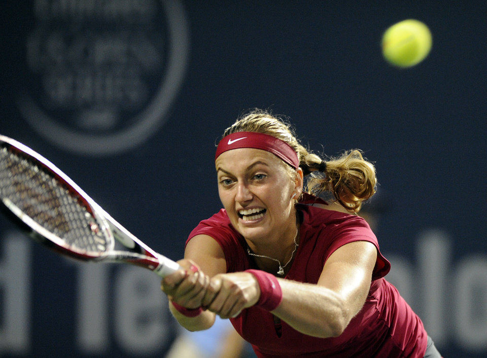 Photo - Petra Kvitova, of the Czech Republic, stretches for a backhand during a semifinal against Samantha Stosur, of Australia, at the New Haven Open tennis tournament in New Haven, Conn., on Friday, Aug. 22, 2014. (AP Photo/Fred Beckham)