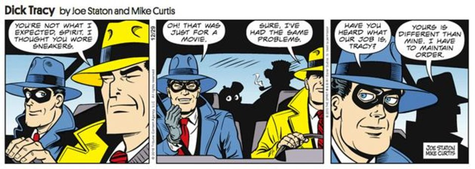 Photo -  The Spirit meets Dick Tracy in the panels of Dick Tracy's comic strip. [Tribune Media Services]