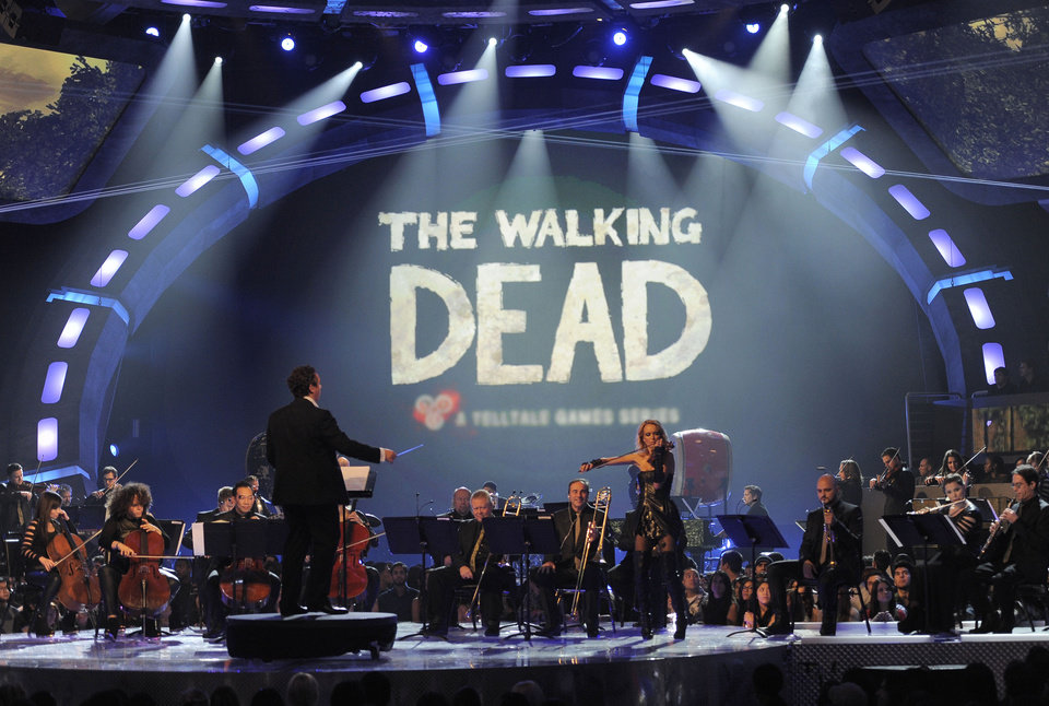 Photo - An orchestra performs the musical themes for game of the year nominees on stage at Spike's 10th Annual Video Game Awards at Sony Studios on Friday, Dec. 7, 2012, in Culver City, Calif. (Photo by Chris Pizzello/Invision/AP)