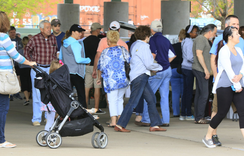 Photo -  A crowd turns out for the opening day of the Edmond Farmers Market at Festival Market Place. [PHOTO BY PAUL HELLSTERN, THE OKLAHOMAN]