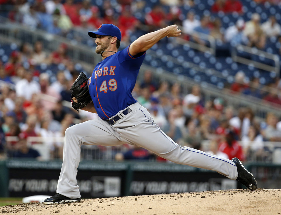Photo - New York Mets starting pitcher Jonathon Niese throws during the third inning of a baseball game against the Washington Nationals at Nationals Park Wednesday, Aug. 6, 2014, in Washington. (AP Photo/Alex Brandon)