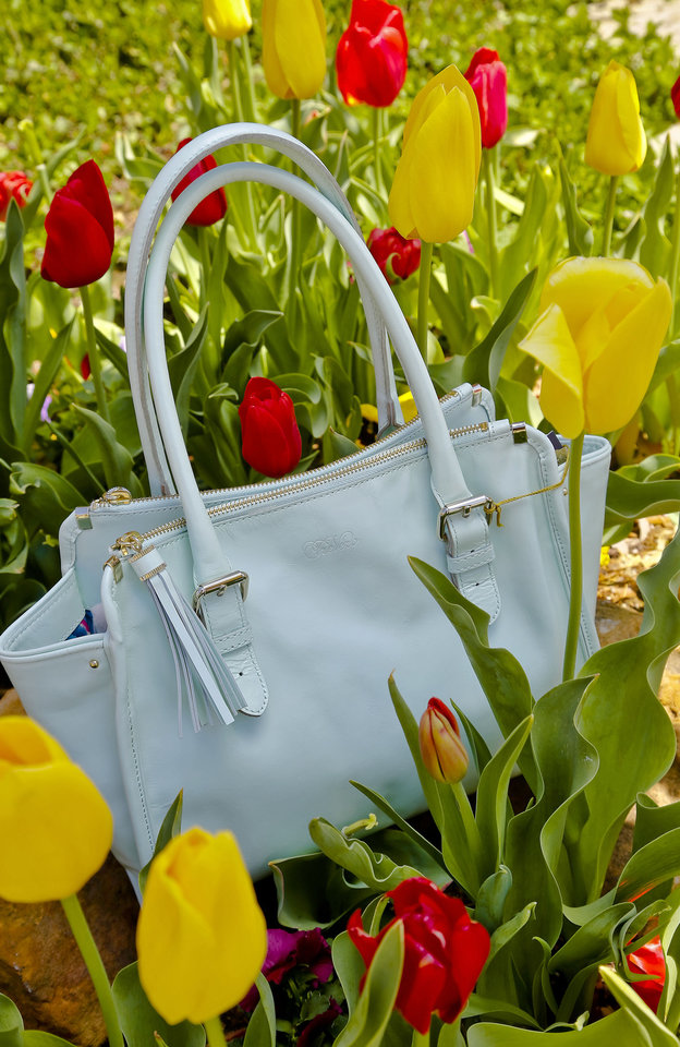 Tre Vero white Claire Satchel, sold at Dillard\'s Penn Square. Photo by Chris Landsberger, The Oklahoman CHRIS LANDSBERGER