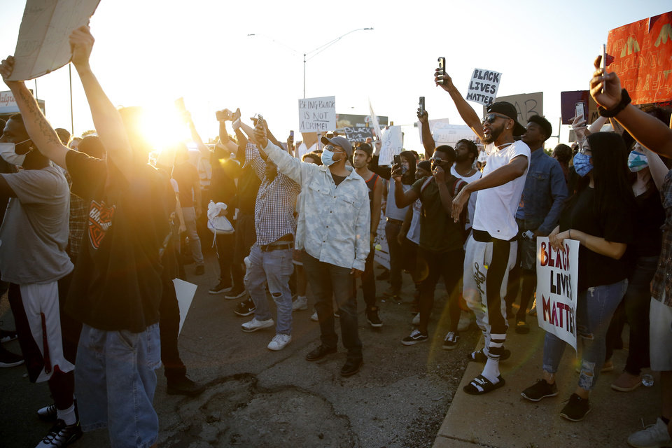 Photo - Protesters chant during a protest near the intersection of 23rd and Classen in Oklahoma City, Saturday, May 30, 2020. The protest was in response to the death of George Floyd. [Bryan Terry/The Oklahoman]