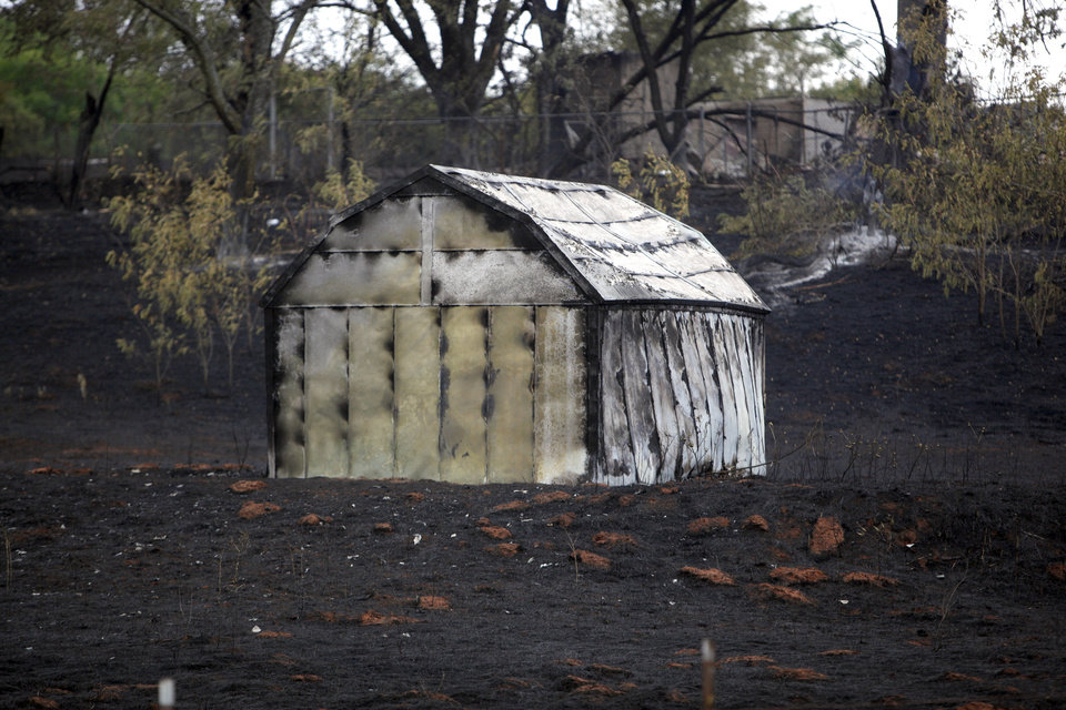 Photo - A barn is pictured near the recycling center in Edmond, Okla.,  Sunday, Aug. 7, 2011. Photo by Sarah Phipps, The Oklahoman