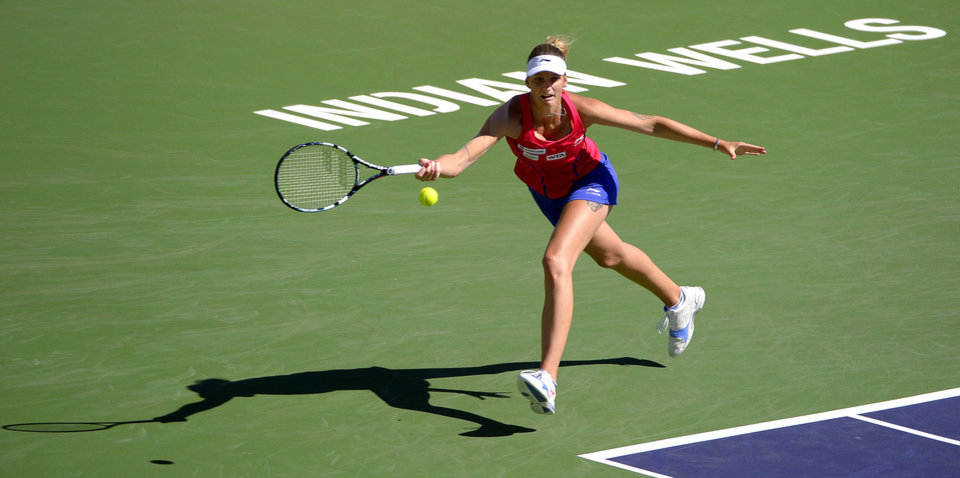 Photo - Karolina Pliskova, of the Czech Republic, returns a volley by Li Na, of China, during a third round match at the BNP Paribas Open tennis tournament, Monday, March 10, 2014 in Indian Wells, Calif. (AP Photo/Mark J. Terrill)