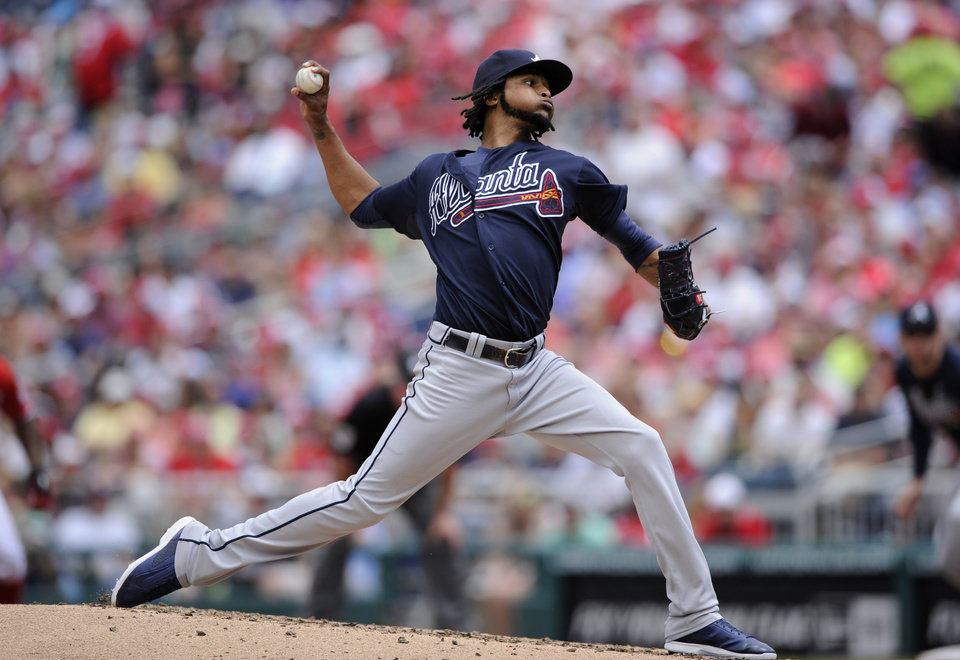 Photo - Atlanta Braves starting pitcher Ervin Santana delivers a pitch against the Washington Nationals during the third inning of a baseball game, Sunday, June 22, 2014, in Washington. (AP Photo/Nick Wass)