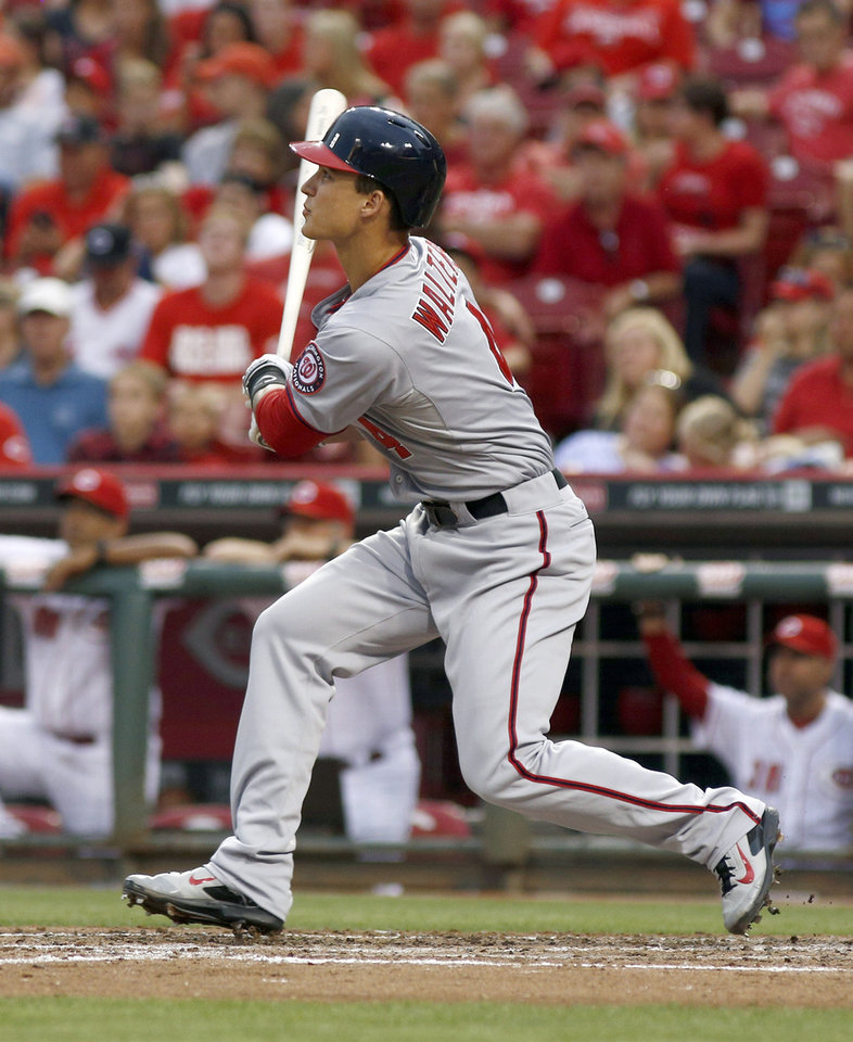 Photo - Washington Nationals' Zach Walters watches an RBI double hit off Cincinnati Reds starting pitcher Alfredo Simon in the fourth inning of a baseball game, Friday, July 25, 2014, in Cincinnati. (AP Photo/David Kohl)