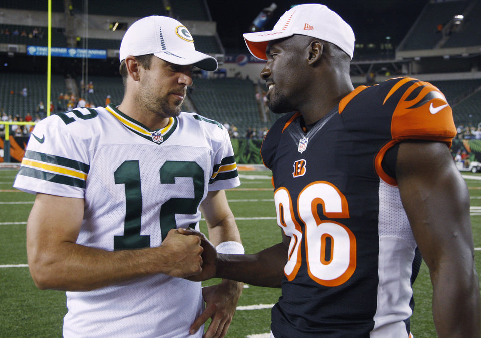 Green Bay Packers quarterback Aaron Rodgers (12) meets with Cincinnati Bengals tight end Donald Lee after an NFL preseason football game, Thursday, Aug. 23, 2012, in Cincinnati. Green Bay won 27-13. (AP Photo/David Kohl)