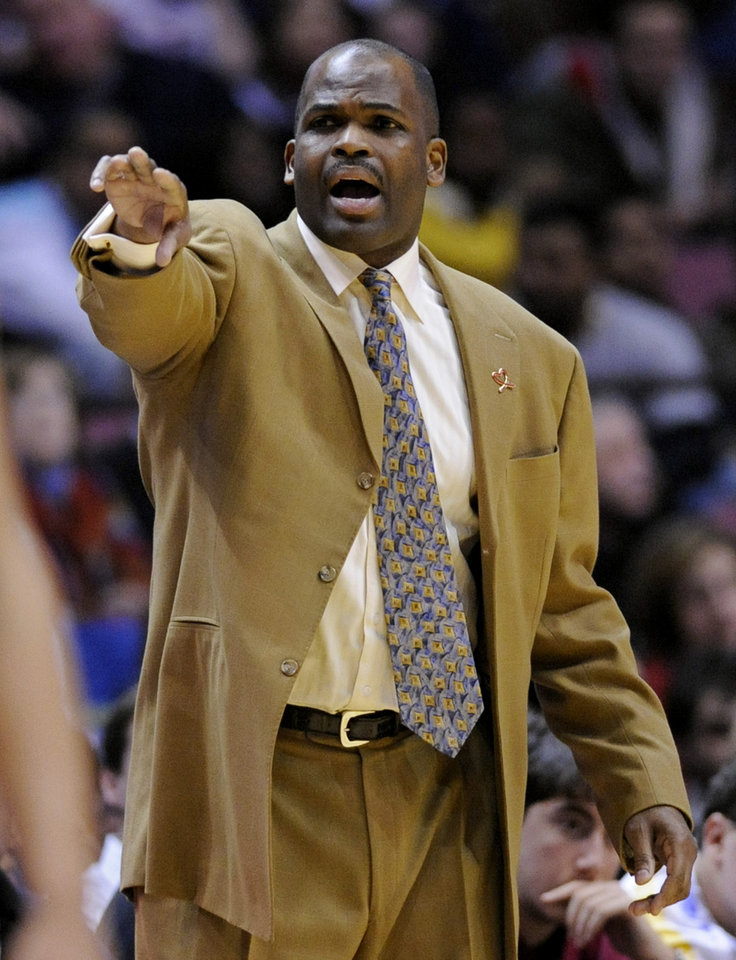Photo - Portland Trail Blazers coach Nate McMillan coaches from the sidelines during the fourth quarter of an NBA basketball game against the New Jersey Nets Thursday night, Jan. 15, 2009 in East Rutherford, N.J. The Trail Blazers beat the Nets 105-99. (AP Photo/Bill Kostroun) ORG XMIT: ERA108