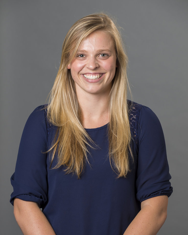 Photo - This 2013 photo provided by the University of Richmond shows director of basketball operations Natalie Lewis. Lewis and associate head coach Ginny Doyle were two of the three people aboard a hot air balloon that drifted into a power line, burst into flames and crashed on Friday, May 9, 2014, in Virginia. Investigators say their remains were found about a mile apart in dense woods. (AP Photo/University of Richmond, Frank Strauss)