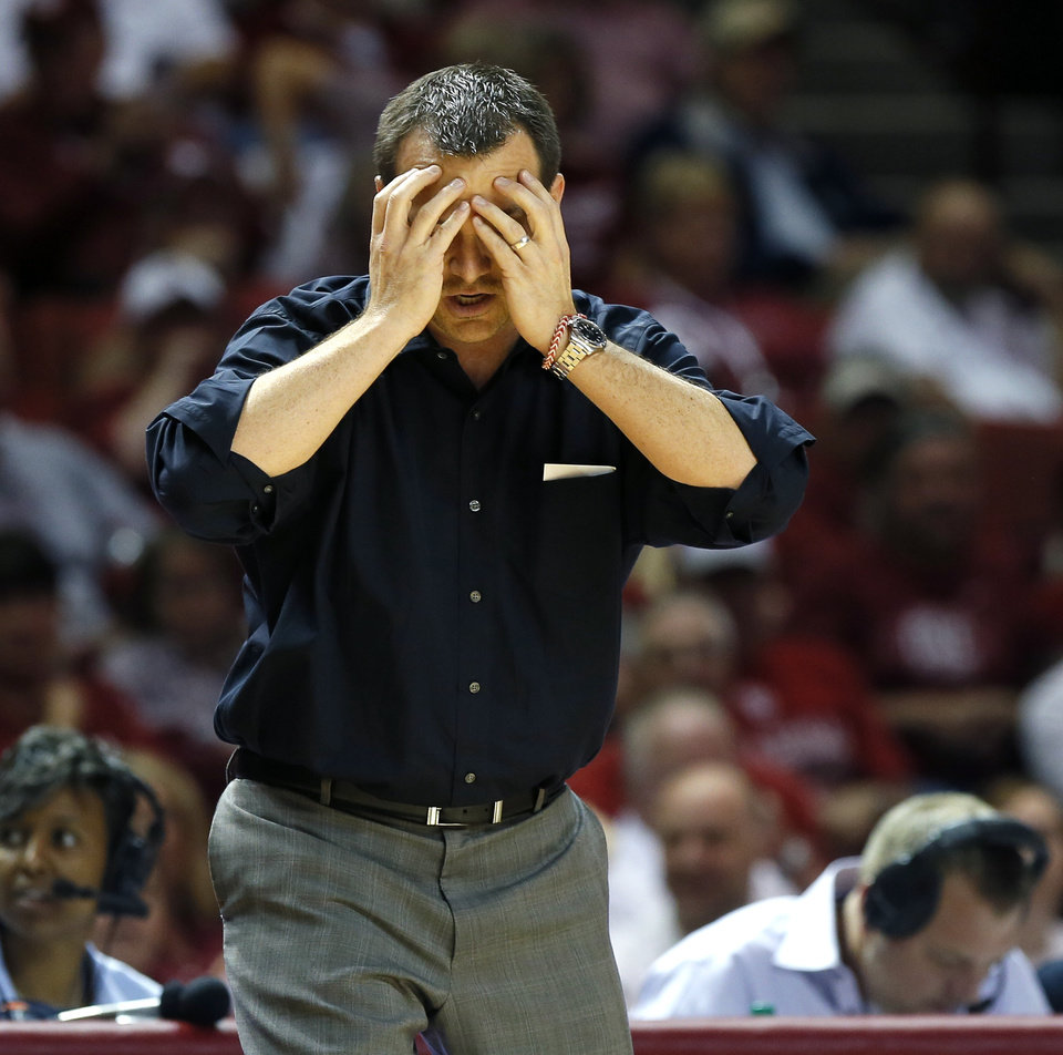 Photo - Louisville coach Jeff Walz stands on the sideline during the first half of an NCAA college basketball game in Norman, Okla., Sunday, Nov. 17, 2013. (AP Photo/Bryan Terry)