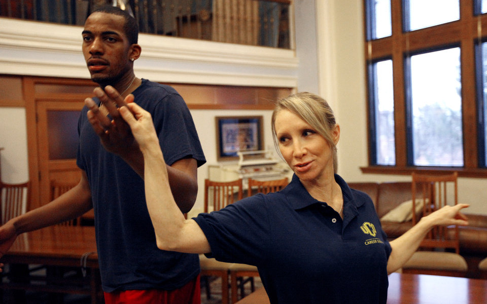 UCO basketball player Antonio Ross and Margo Waldrop, an administrative assistant, practice for a dancing fundraiser at Evans Hall on the campus of the University of Central Oklahoma in Edmond, Okla., Thursday, Feb. 2, 2012. Photo by Sarah Phipps, The Oklahoman
