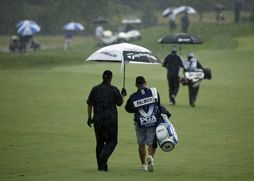 Photo - Ryan Palmer walks down the fairway on the first hole during the second round of the PGA Championship golf tournament at Valhalla Golf Club on Friday, Aug. 8, 2014, in Louisville, Ky. (AP Photo/Jeff Roberson)