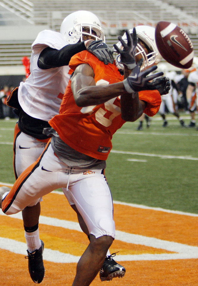 Photo - OSU's Adrian Richards (15) misses catching a pass in the end zone as Danje Martin (15) defends during the Oklahoma State Orange and White spring football game at Boone Pickens Stadium in Stillwater, Okla., Saturday, April 17, 2010. Photo by Nate Billings, The Oklahoman