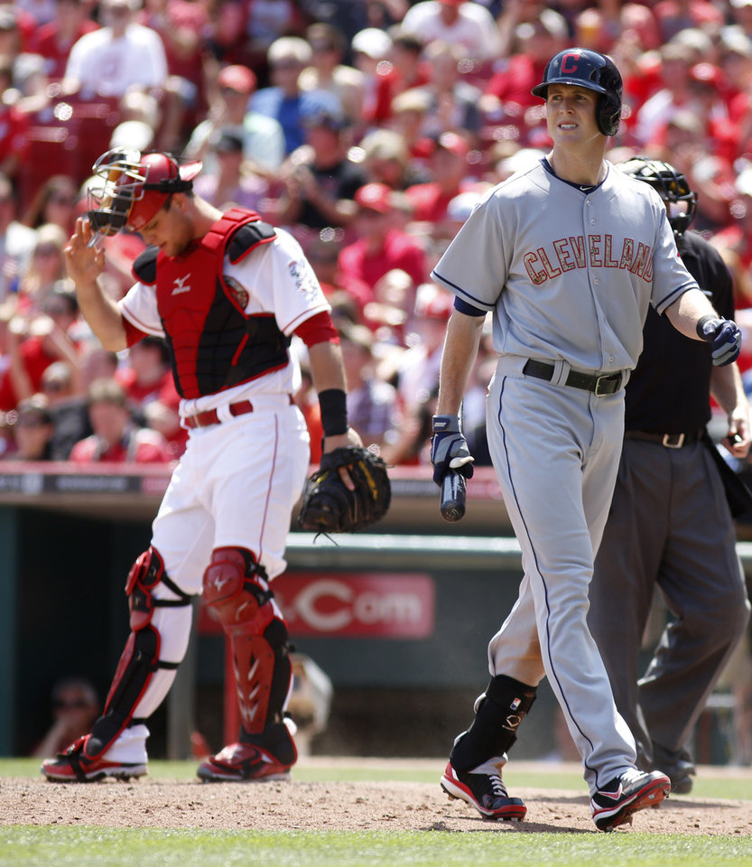 Photo - Cleveland Indians' Drew Stubbs, right, walks from the plate past Cincinnati Reds catcher Devin Mesoraco after striking out in the eighth inning during a baseball game, Monday, May 27, 2013, in Cincinnati. The Reds won 4-2. (AP Photo/David Kohl)