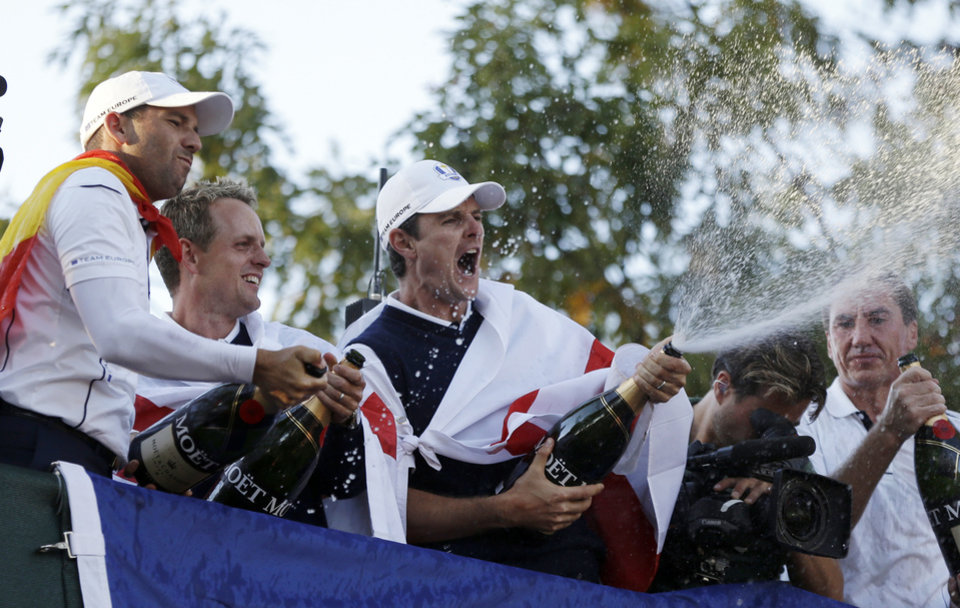 Europe's Sergio Garcia, left to right, Luke Donald and  Justin Rose celebrate after winning the Ryder Cup PGA golf tournament Sunday, Sept. 30, 2012, at the Medinah Country Club in Medinah, Ill. (AP Photo/Chris Carlson)  ORG XMIT: PGA243