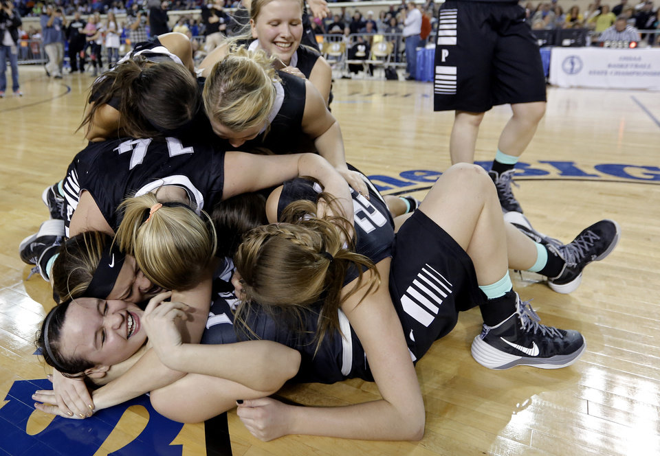 Photo - The Pond Creek-Hunter girls celebrate the win over Seiling during the Class A girls high school basketball state championship game between Seiling and Pond Creek-Hunter at the State Fair Arena in Oklahoma City, Okla., on Saturday, March 8, 2014.  Photo by Chris Landsberger, The Oklahoman
