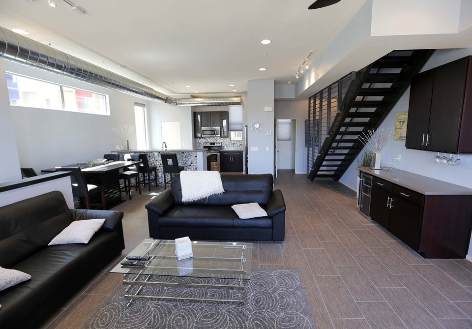 Photo - This June 4, 2014 photo shows the interior of attorney Tim Nelson's home at the newly built Portland townhouse development in Phoenix. Americans like Nelson increasingly say they prefer to live near the centers of cities and towns, where commutes tend to be easier and culture, restaurants and entertainment close by. It marks a pronounced shift away from the yearning for open suburban space that drove U.S. home construction for decades. (AP Photo/Matt York)