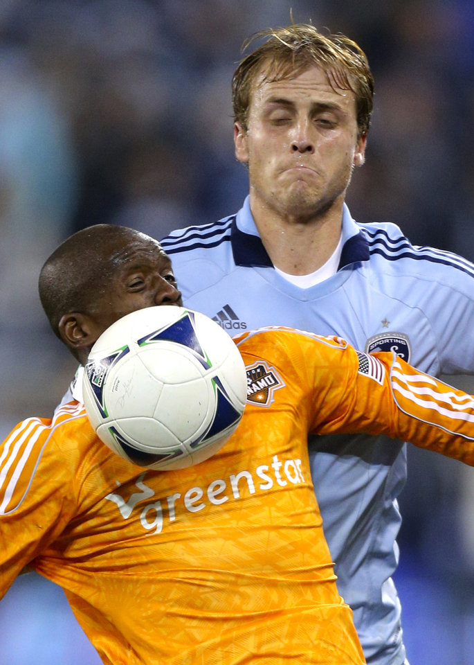 Photo -   Houston Dynamo's Boniek Garcia, front, gains control of the ball against Sporting Kansas City's Seth Sinovic during the second half of an MLS soccer playoff game Wednesday, Nov. 7, 2012, in Kansas City, Kan. (AP Photo/Ed Zurga)
