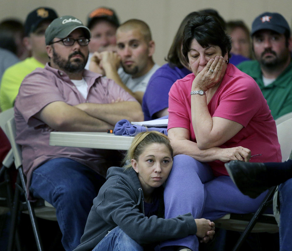 Photo - Displaced resident Jeanette Sulak and her daughter Jill Sulak-Vrla listen during a town hall meeting Saturday, April 20, 2013, three days after an explosion at a fertilizer plant in West, Texas. The massive explosion at the West Fertilizer Co. Wednesday night killed 14 people and injured more than 160. (AP Photo/Charlie Riedel)