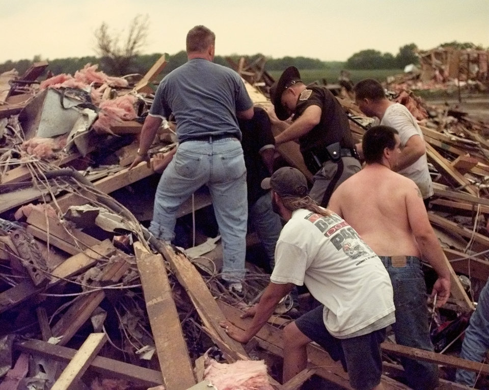 May 3, 1999 Oklahoma City Tornado:  Tornado victims, damage: Rescue workers try to remove Renee Faulkinberry from the rubble of her home in the Country Place Estates housing addition SW of 134th and S. Penn. About a dozen volunteers worked for nearly a half hour to free Renee.  Staff Photo by Paul Hellstern