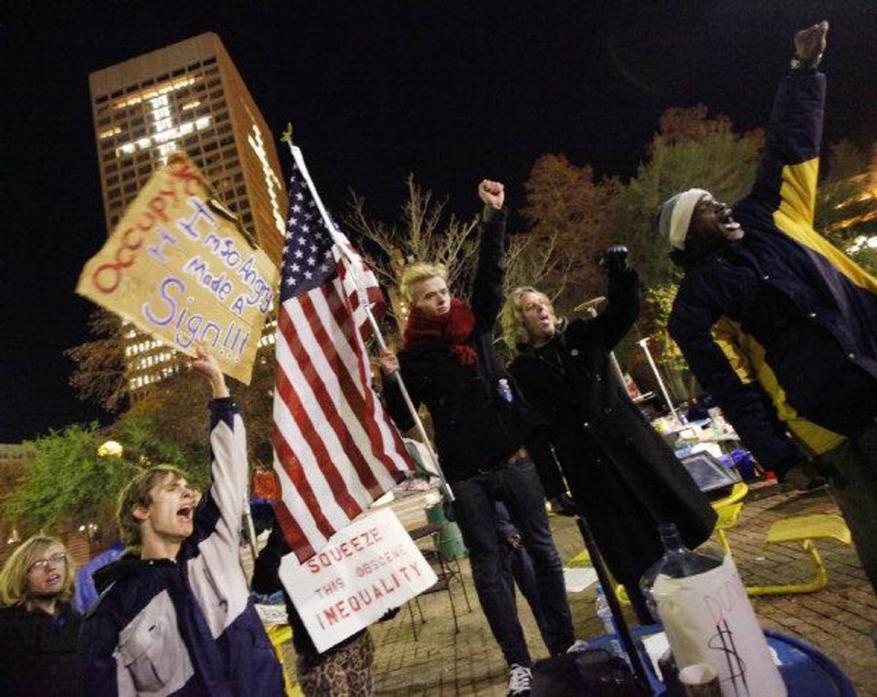 Photo - Protesters chant inside Kerr Park in Oklahoma City, late Tuesday, Nov. 29, 2011. Occupy OKC's permit to stay overnight in the park was not renewed Monday. Photo by Nate Billings, The Oklahoman
