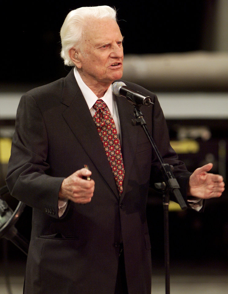 Photo - The Rev. Billy Graham addresses the media from the floor of the Ford Center in downtown Oklahoma City, Tuesday morning, June 10, 2003. Graham is in town to speak at Mission Oklahoma City Thursday through Sunday at the Ford Center. Staff photo by Doug Hoke.